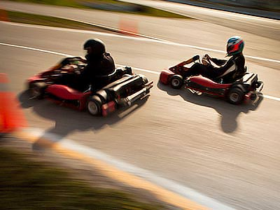 Two go karts racing around a track