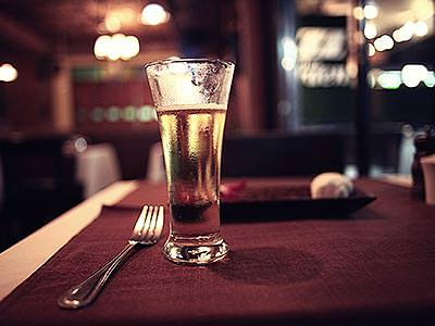 A glass of beer on a restaurant table