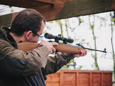 A man firing a gun into the distance
