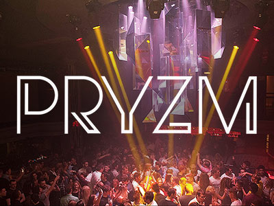 A view over a large dance floor filled with people with the Pryzm logo over the top