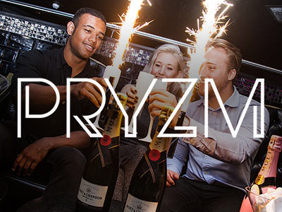 Three people clinking white flute glasses behind two bottles of champagne with sparklers attached