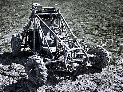Stationary mud buggy on a muddy field
