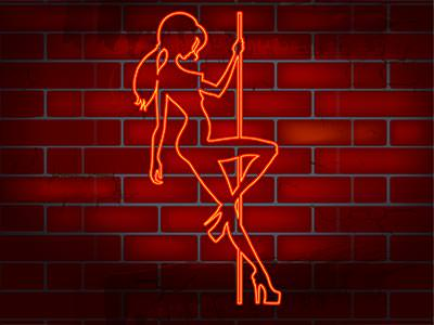 A red neon sign depicting a woman dancing on a pole, set against a red brick wall