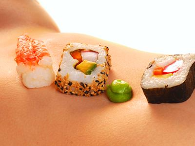 Sushi on a naked woman's stomach
