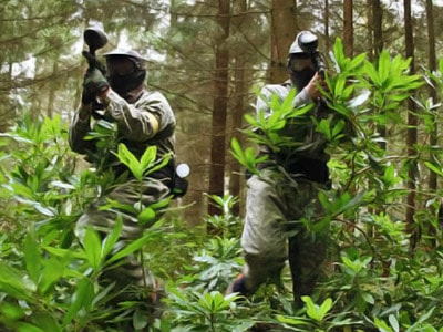 Two men in the woods with paintball guns