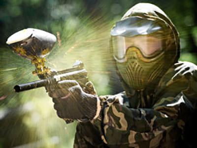 A person firing a paintball gun