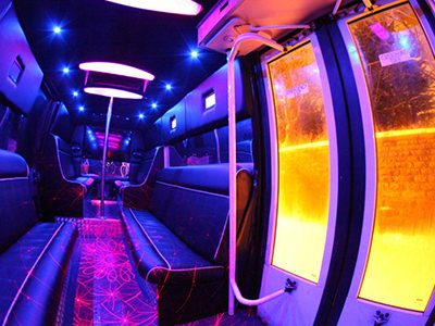 The purple-style interior of the private party bus with yellow doors on the side