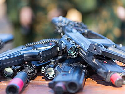 Close up of guns on top of each other