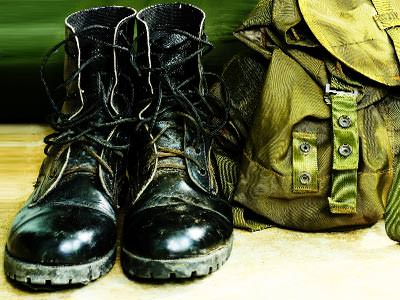 A soldier's boots and backpack