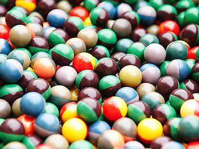 A close up of many multicoloured paintballs