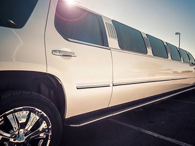 A stretch SUV-style limousine with chrome wheels