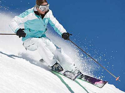 A person skiing against a blue sky