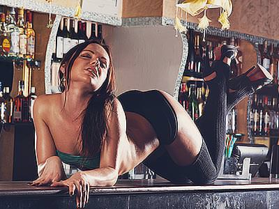 A women wearing underwear posing on a bar top