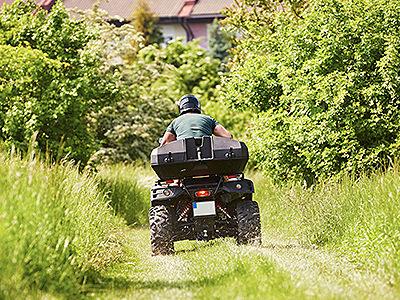 A man driving a quad bike in a field