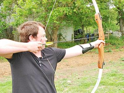 A man firing an arrow from a bow