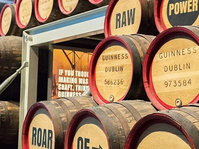 Stacks of wooden barrels with information on relating to the production of Guinness