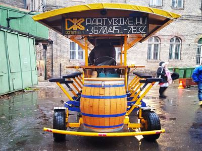 The rear of a yellow beer bike