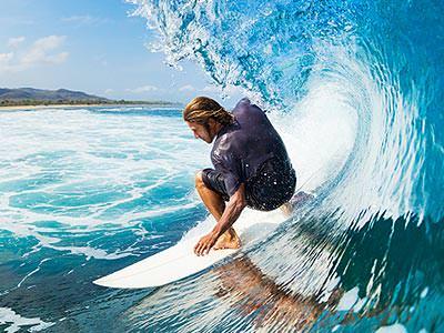A man surfing a huge wave