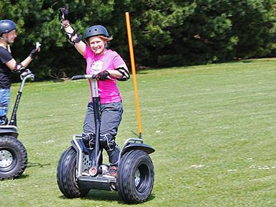 A woman driving a Segway on a pitch