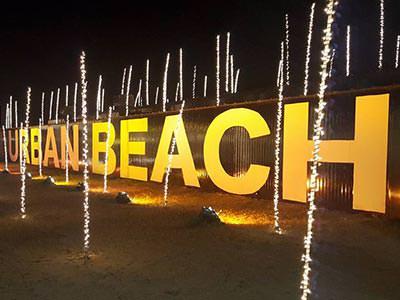 Urban Beach lettering illuminated at night