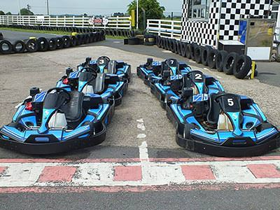 Two lines of blue go karts