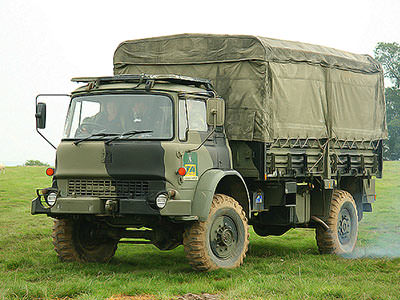 An army vehicle parked in a field