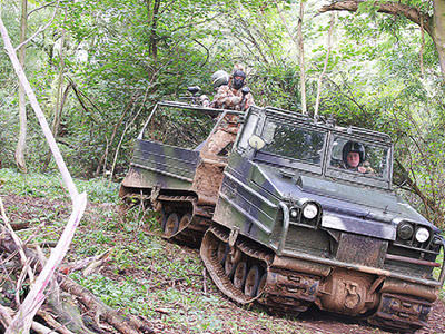 People in tanks in the forest