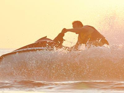 A man riding a jet ski on the sea