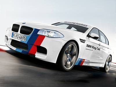 A white BMW saloon with red and blue livery