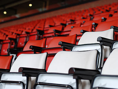 Some red and white seats in a stadium