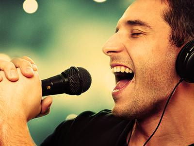 A man singing into a mic