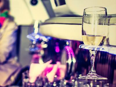 A glass of champagne pictured in a holder in the interior of a vehicle