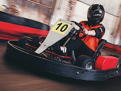 The number 10 go kart driving around a track