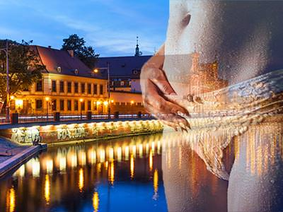 An image of riverside buildings at night overlaid with an image of a woman wearing underwear