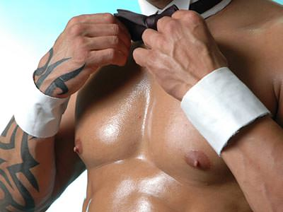 A semi-naked male torso, in white cuffs and a collar