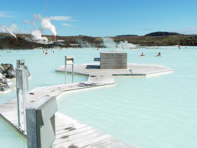 A view of walkways at the Blue Lagoon, with the main pool in the background