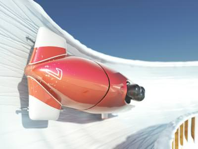 A red bobsleigh horizontal whilst making a banked turn on an ice track