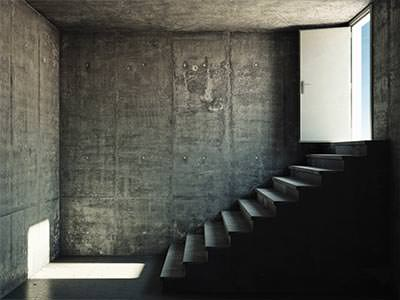 An empty room with a staircase leading outside