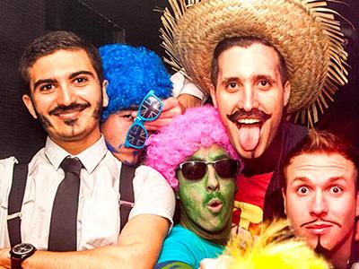 Group of men in various fancy dress costumes.