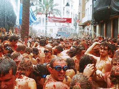 People in the street at the La Tomatina festival in Valencia