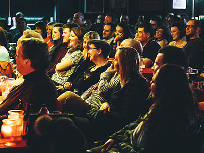 A large audience watching the stage