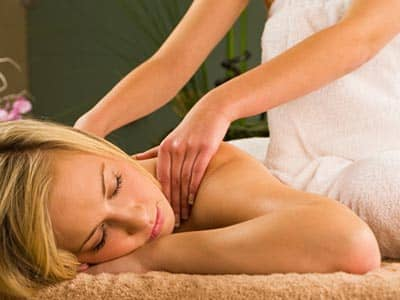 A woman receiving a back massage
