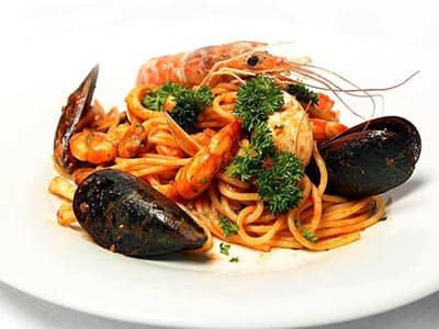 Mussels and linguine on a white plate
