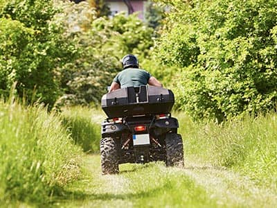 A man heading into the distance on a quad bike