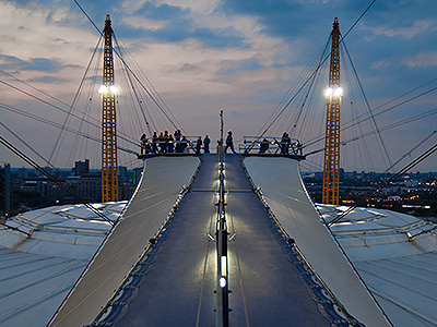 A group of people on top of The O2 Arena at night
