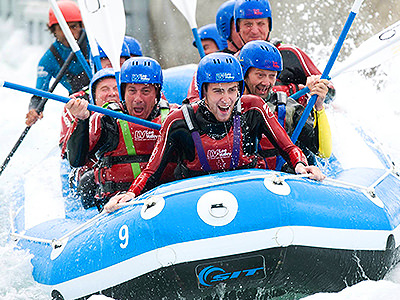 Group of men olympic white water rafting in London