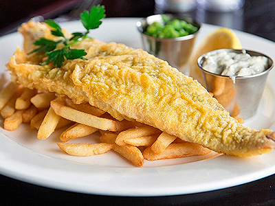 Fish and chips on a white plate