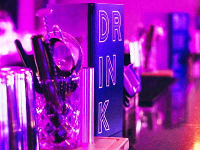Cocktail making equipment and drinks menu on the bar