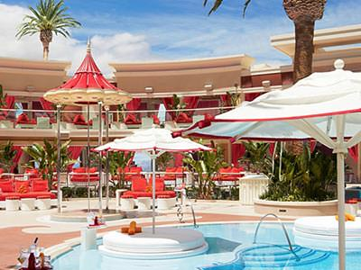 The outdoor pool, beds and cabanas at the Encore Beach Club