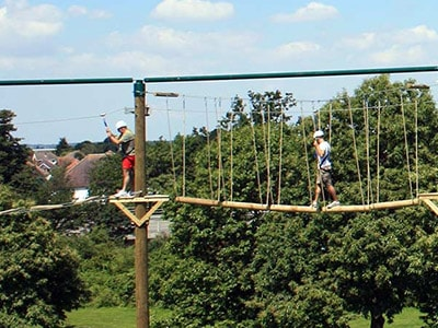 Two men on a high ropes course in Bournemouth